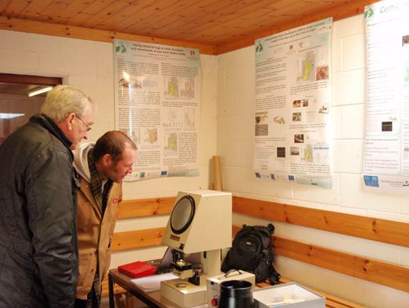 Examining a sea trout scale at the Brenig Open Day